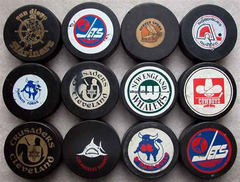 Mostly WHA Hockey Puck Group of 56: GAMEWORNAUCTIONS